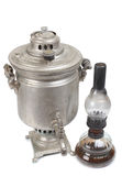 Retro lamp and samovar Stock Photos