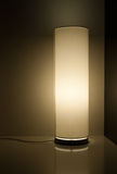 Retro lamp on a shiny table. Retro lounge tube lamp on a shiny white table Royalty Free Stock Photos