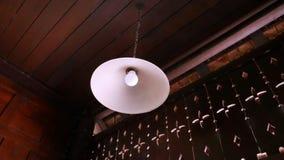 Retro Lamp and White Round Luminaire Hanging from the Ceiling. Retro Vintage Lamp and White Round Luminaire Hanging from the Ceiling royalty free stock photos