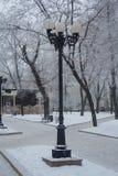Retro lantern on a snowy city boulevard Stock Image