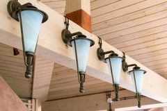 Retro lanterns mounted on a wooden interior Royalty Free Stock Image