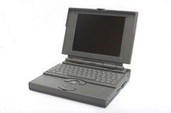 Retro Laptop. Old laptop isolated on white background Stock Photo