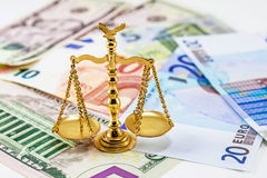 Retro law scales on different banknotes. Symbol of justice Stock Photo