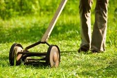 Retro lawn mower. Old, cast iron lawn mower Stock Photos