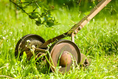 Retro lawn mower in action. Old, cast iron lawn mower in action Royalty Free Stock Photos