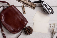 Retro leather bag and photo Royalty Free Stock Images