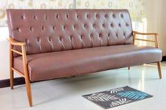 Retro leather sofa in room Stock Image