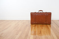 Retro leather suitcase on wooden floor Royalty Free Stock Image