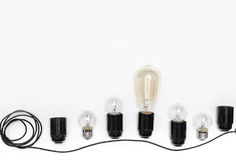 Retro Light Bulb, Cartridges And Wires For Retro Garlands On A White Background Isolated. View From Above Royalty Free Stock Photography