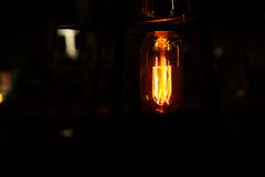 Retro light bulb in the dark background at night Royalty Free Stock Photo