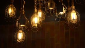 Retro Light Bulb Lighting Series. Lights with brick wall. stock footage
