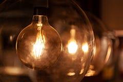 Retro light bulbs with cozy warm light. Closeup of trendy retro light bulbs with cozy warm light - shallow focus royalty free stock photography