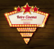 Retro light frame. Cinema poster in a gold frame on the background of a wooden, a movie template for the layout, banner and cover. Vector illustration Stock Photos