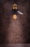 Retro light lamp against dark grunge background Royalty Free Stock Images