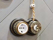 Retro light switch and socket Royalty Free Stock Photo