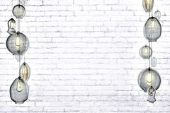 Retro lightbulbs on a brick wall Royalty Free Stock Images