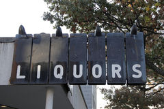 Retro liquor store sign. A retro liquor store sign hangs above Royalty Free Stock Photos