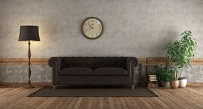 Retro living room with leather sofa stock images