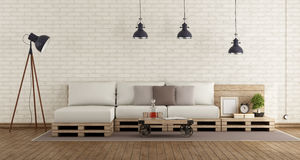 Retro living room with pallet sofa. Retro living room with brick wall and pallet sofa - 3d rendering Royalty Free Stock Photos