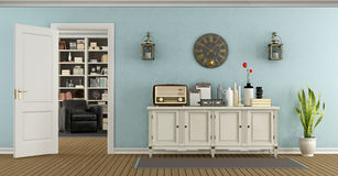 Retro living room with sideboard and open door Stock Photo