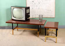 Retro Living Room with TV, Tables and Artwork Royalty Free Stock Images