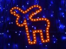 Retro ljus i form av julhjortar bland julljus Royaltyfria Foton