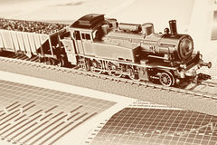 Retro Locomotive Model on graphs Stock Photos