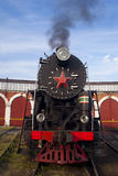 Retro locomotive. A steam engine locomotive in the depot Royalty Free Stock Photography