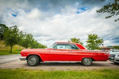 Retro long American car Chevrolet of red colour Royalty Free Stock Photo