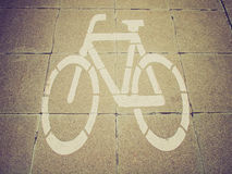 Retro look Bike lane sign Royalty Free Stock Photography