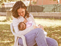 Retro look Breastfeeding Royalty Free Stock Photos