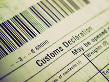 Retro look Customs declaration. Vintage looking Customs declaration on a foreign packet parcel Royalty Free Stock Photo