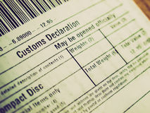 Retro look Customs declaration. Vintage looking Customs declaration on a foreign packet parcel Royalty Free Stock Image