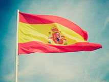 Retro look Flag of Spain. Vintage looking Flag of Spain over a blue sky Royalty Free Stock Image