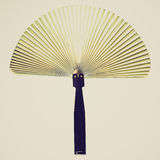 Retro look Hand held fan. Vintage looking Hand held fan used to induce an airflow for cooling or refreshing oneself - isolated over white background Royalty Free Stock Images