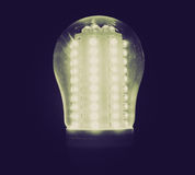 Retro look LED Light Bulb. Vintage looking A lit LED Light Emitting Diod bulb Royalty Free Stock Photo