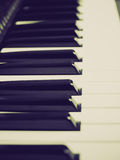 Retro look Music keyboard. Vintage looking Detail of black and white keys on music keyboard - selective focus Stock Photos