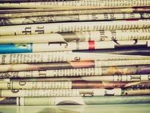 Retro look Newspapers. Vintage looking Detail of a pile of international newspapers Royalty Free Stock Photos