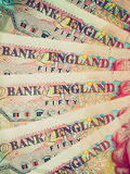 Retro look Pounds picture. Vintage looking Detail of British Pounds banknotes money Stock Image