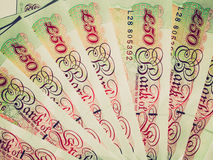 Retro look Pounds picture. Vintage looking Detail of British Pounds banknotes money Royalty Free Stock Photos