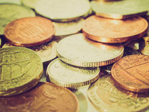 Retro look Pounds picture. Vintage looking Range of British Pounds coins (UK currency Royalty Free Stock Image