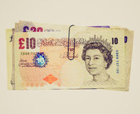 Retro look Pounds. Vintage looking Detail of British Pounds GBP banknotes money Royalty Free Stock Photography