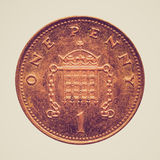 Retro look Pounds. Vintage looking One Penny coin isolated over white background Royalty Free Stock Photo