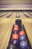Retro look red, blue and purple bowling ball Stock Photos
