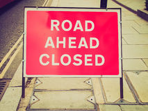 Retro look A sign. Vintage looking A traffic or a construction site sign - Road ahead closed royalty free stock image