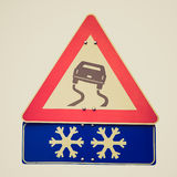 Retro look Slippery road sign Royalty Free Stock Photos