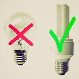 Retro look Traditional vs Fluorescent Light bulb Stock Photos