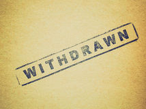 Retro look Withdrawn. Vintage looking Withdrawn stamp on a book page Royalty Free Stock Photo