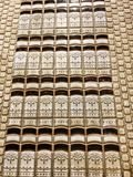 Tiling That Looks Like Library Books Stacked with Fleur De Lis Design. Retro looking ceramic tile that shows book ends stacked and surrounded by square tiling Royalty Free Stock Images
