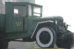 Retro lorry truck. Green color, down side. Body, silver exhaust pipe, car wheel.  Stock Photos